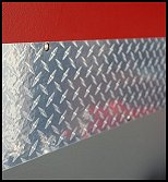 "Diamond Plate Vinyl Sheet Roll Decal. High-gloss, durable, scratch resistant - this film creates the realistic illusion of diamond plate with the ""flashiness"" of chrome accents - peel and stick wall decor"